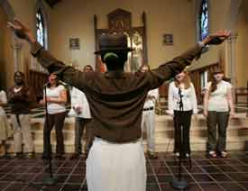 Members of Fordham's Rhythm of Praise Gospel Choir sing out during Psalms in the Night at the University Church on Sept. 30. Photo by Bruce Gilbert