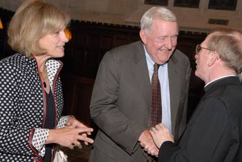 Joseph M. McShane, S.J., president of Fordham, greets E. Gerald Corrigan and his wife, Cathy E. Minehan, during a celebration in Corrigan's honor. Photo by Chris Taggart