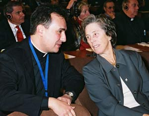 Stefano Del Bove, S.J., graduate assistant at Fordham's Center for Non-Public Education, takes in the proceedings with Louise Oliver, United States ambassador to UNESCO.