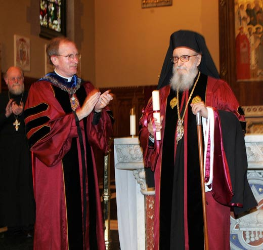 Joseph M. McShane, S.J., president of Fordham, applauds His Eminence Archbishop Demetrios, primate of the Greek Orthodox Church in America, after presenting him with his doctorate of humane letters, honoris causa. Photo by Bruce Gilbert