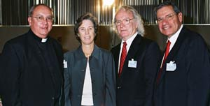 Vincent J. Duminuco, S.J., rector of the Fordham Jesuit Community; Louise Oliver, United States ambassador to UNESCO; James Hennessy, Ph.D., dean of Fordham's Graduate School of Education; and John Tognino, chairman of the Fordham Board of Trustees.