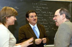 (Left to right) Lisa Finnegan, GSE '03, Harold Takooshian, Ph.D., professor of psychology and Paul Levinson, Ph.D., professor of communication and media studies. Photo by Ken Levinson