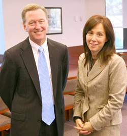 Timothy P. Flynn, chairman and chief executive of KPMG, LLP, with Donna Rapaccioli, interim dean of CBA. Photo by Michael Dames
