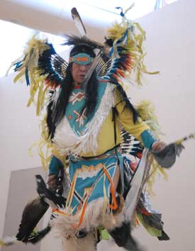 A dancer from the Red Hawk Native American Arts Council performs at the McGinley Center during Focus the Nation. Photo by Chris Taggart