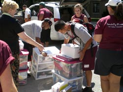 Rams football players lend a helping hand to incoming freshman during move-in day on Sept. 2. Photo by Vincent Dusovic