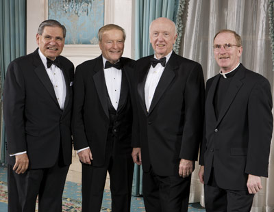 John Tognino, FCLS '75, chairman of Fordham's Board of Trustees (left), honorees Herbert Granath and Robert Campbell, and Joseph M. McShane, S.J., president of Fordham  Photo by Jon Roemer