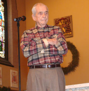 Daniel Berrigan, S.J., on stage at the University Church. Photo by Chris Taggart