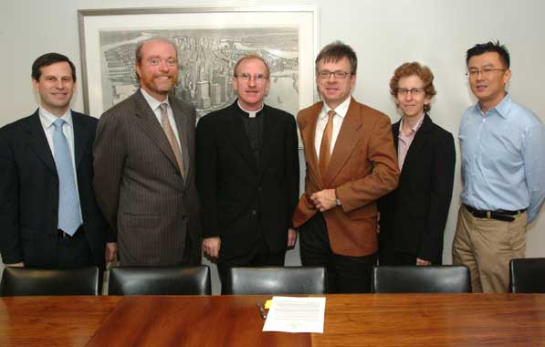 Fordham University's School of Law and Bucerius Law School in Hamburg, Germany, have signed a student exchange agreement to go into effect in Fall 2007, under which two students from each institution may spend a semester at the partner school. Pictured at the ceremonial signing of the agreement are, from left to right: Joel Reidenberg, J.D., professor of law and founding director of the Center on Law and Information Policy; William M. Treanor, J.D., dean of Fordham Law School; Joseph M. McShane, S.J., president of Fordham; Hans-Dieter Stell, Ph.D., deputy consul general of the German Federal Republic; Toni M. Fine, J.D., assistant dean for International and Non-JD Programs; and Thomas H. Lee, J.D., associate professor of law.