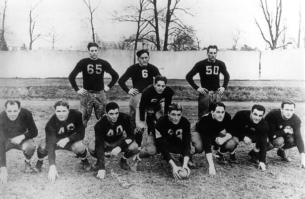 """""""Handy"""" Andy Palau (with hands on knees) was the quarterback on the Fordham football teams that featured the  Seven Blocks of Granite. Photo courtesy of Fordham University Archives."""
