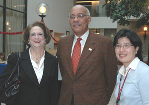 Penny Schwartz, D.S.W. (left), with Peter B. Vaughan, Ph.D., dean of the Graduate School of Social Service, and Ji Seon Lee, Ph.D., assistant professor of social service, who organized the event. Photo by Meredith Hanson