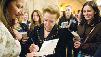 "Mary Higgins Clark signs a book for a fan after her lecture on ""Life After Fordham"" on March 4.  Photo by Ryan Brenizer"