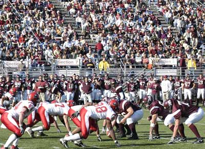The Rams and Red Foxes square off on the scrimmage line at the Homecoming game. Photo by Chris Taggart