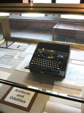 "An old royal typewriter is just one of the ""artifacts and oddities"" on display as part of an exhibition on the centennial of the Fordham University Press. Photo by Janet Sassi"