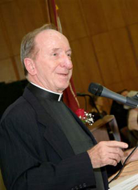 """Father Eugene Lauer: Christianity needs to be brought down to """"a very earthy, pastoral level."""" Photo by Chris Taggart"""
