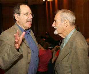 Paul Levinson, Ph.D., chair of Communication and Media Studies, talks with Allen Flagg, president of the New York Society for General Semantics. Photo by Bruce Gilbert