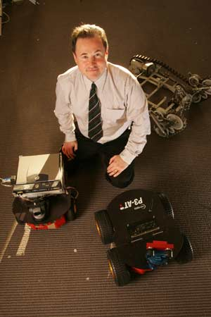 Damian Lyons, Ph.D., hopes to build a robot capable of probing disaster-recovery sites. Photo by Bruce Gilbert