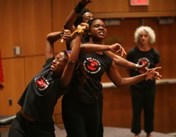 Members of Big Apple Playback Theatre act out some of the reasons first-year Fordham Law School students chose to pursue legal studies. Photo by Bruce Gilbert