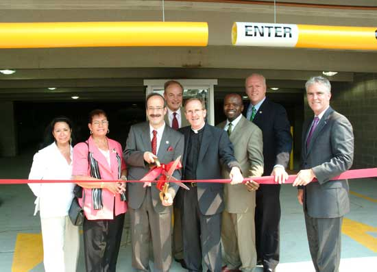 The ribbon cutting ceremony, from left to right: Ivine Galarza, district manager, Bronx Community Board 6; Wendy Rodriguez, chairperson Bronx Community Board 6; Rep. Eliot L. Engel, D-N.Y.; New York City Councilman G. Oliver Koppell; Joseph M. McShane, S.J., president of Fordham; Hon. Earl Brown, deputy Bronx borough president; Rep. Joseph Crowley D-N.Y.; and John Cahill, chief of staffto Governor George Pataki. Photo by Chris Taggart