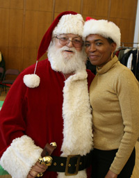 Francoisline Freeman, assistant director of Student Financial Services, enjoys a laugh with Santa Claus. Photo by Michael Dames