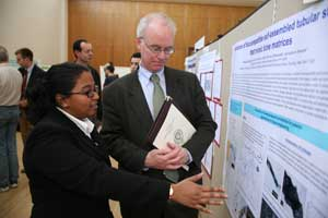 Senior Marsiyana Henricus explains her research to Brennan O'Donnell, Ph.D., dean of Fordham College at Rose Hill.  Photo by Michael Dames