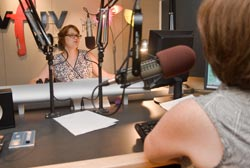 Claudia Marshall (left), host of WFUV's City Folk Morning, chats on the air with co-host Julianne Welby. The station's corporate underwriting has tripled in the past four years.  Photo by Ryan Brenizer