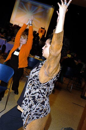 Attendees at the WE LEARN conference participate in a session of meditation and chair yoga. Photo by Ken Levinson