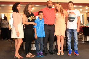 Carmen Betancourt (second from right) celebrates with her family.