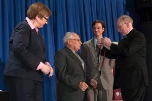 Gustavo Gutierrez receives Fordham's highest honor, the President's Medal, from Joseph M. McShane, SJ, president of FordhamPhotos by Leo Sorel