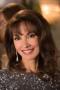 Susan Lucci as Genevieve Delatour on the Lifetime series Devious Maids