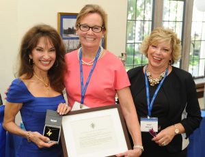 Marymount Alumnae Association Board members Jean Wynn, MC '80 (center), and Joyce Abamont, MC '66 (right), present Susan Lucci with the Alumna of Achievement Award. (Photo by Chris Taggart)