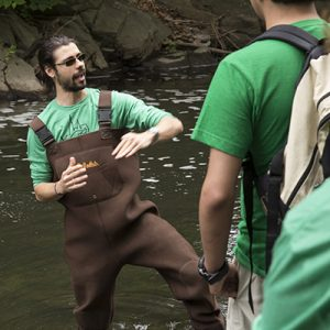 Grad student Corey Anko explains eel migration in the Bronx River.