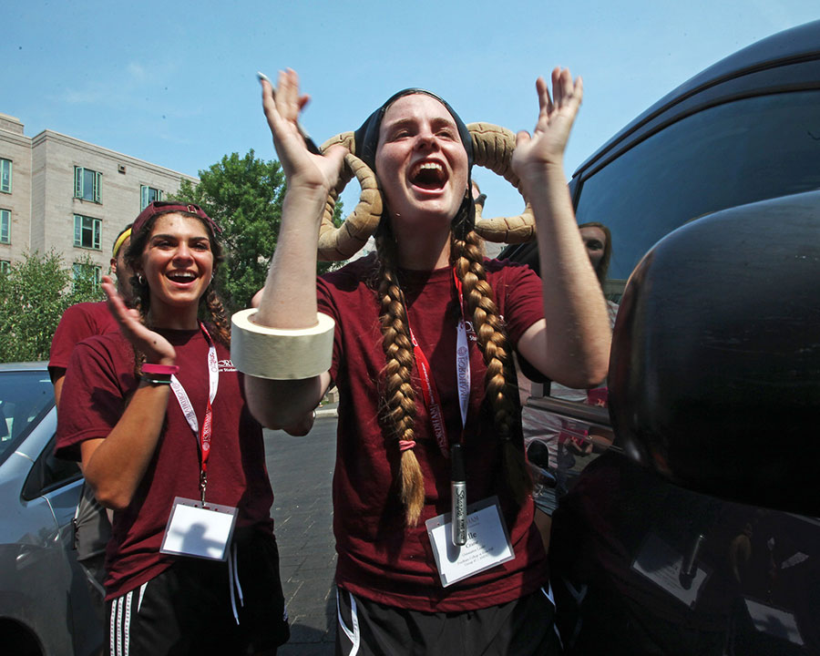 Each year during the freshmen move-in, FCRH senior Elle Crane dons the ram horns she caught at a Fordham basketball game her first year at Fordham. Photo by Bruce Gilbert