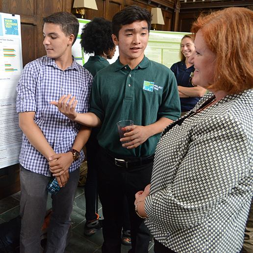 Sophomore Abdel Rahman Mohamed and high school student Henry Takizawa explain their research to Amy Tuininga. Photo by Tom Stoelker