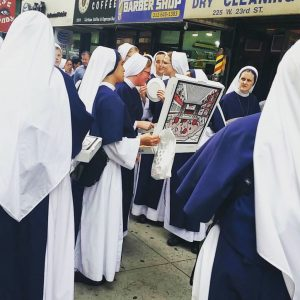 A group of Sisters of Life ordered a pizza after hours of waiting in line to enter Madison Square Garden for the Papal Mass. Photo by Joanna Mercuri