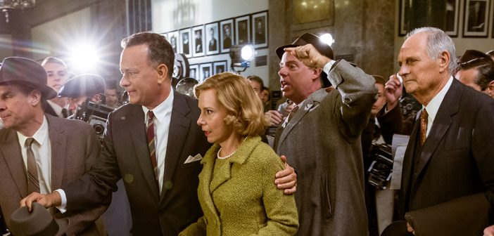 In a scene from Bridge of Spies, Tom Hanks (second from left) plays James B. Donovan, the real-life Fordham graduate who defended accused Soviet spy Col. Rudolf Abel in New York City in 1957. Fordham alumnus Alan Alda, FCRH '56 (right), plays Thomas Watters, Donovan's law partner. Jaap Buitendijk / DreamWorks and Twentieth Century Fox
