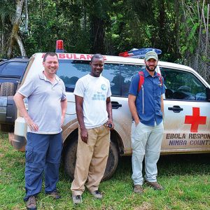 Epidemiologist Joseph Woodring, DO, FCRH '98 (left), in Liberia last year.
