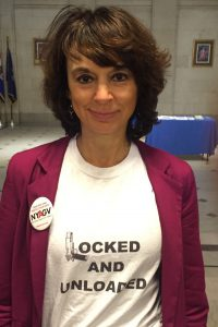 "Leah Gunn Barrett brandishes the""Locked and Unloaded"" message in Albany."