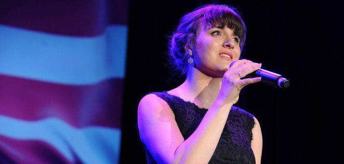 Kathryn Ott sings the national anthem.