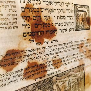 Seder Haggadah in Yiddish and Hebrew from 1765, stained with wine from the ritual