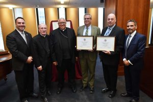 Thomas Kane and Christopher Signor, principals from the Diocese of Albany, were among those honored.