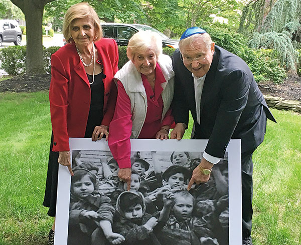More than 72 years after they'd been filmed together at the liberation of Auschwitz, Tovah Friedman, Sarah Ludwig, and Michael Bornstein discovered that they live near each other in suburban New Jersey. They gathered with their families on June 4, 2017. (Courtesy of Debbie Bornstein Holinstat)