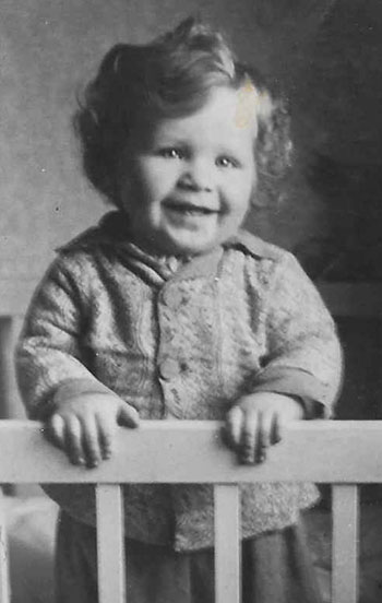 "Michael Bornstein as a baby in Żarki, Poland. ""I shared all of my mother's fair features, with milk-white skin, a mess of dirty-blond curls, and bright blue eyes—rare coloring for a Jew,"" he writes."