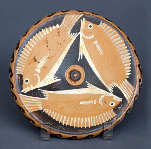 Fish plate, Greek, South Italian, Campainian, red-figure, Late Classical, ca. 340 to 320 B.C.E. Terracotta, d: 6¾ in. (17.1 cm), from the Fordham Museum of Greek, Etruscan, and Roman Art