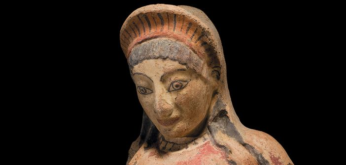 A terracotta antefix depicting an Etruscan woman, one of 260-plus antiquities in the Fordham Museum of Greek, Etruscan, and Roman Art