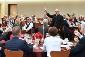 Father McShane delivers a toast in the student center's new multi-purpose space. Photo by Dana Maxson