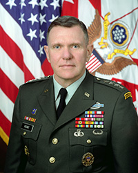 General Jack Keane, a 1966 graduate of Fordham's Gabelli School of Business, was at the Pentagon on September 11, 2001. Top: The Pentagon Memorial honoring the 184 people killed at the Pentagon and on American Airlines Flight 77 on 9/11.