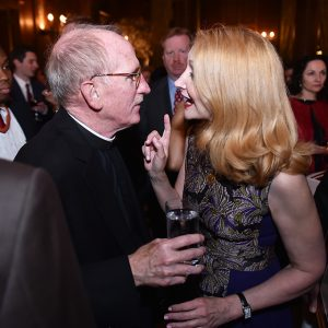 Father McShane and honoree Patricia Clarkson