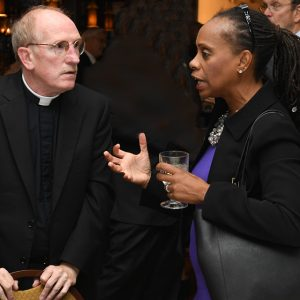 Father McShane with Anne Williams-Isom.