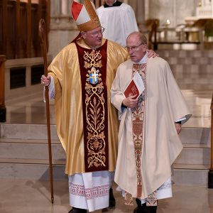 Cardinal Dolan and Father McShane on the altar at St. Patrick's.