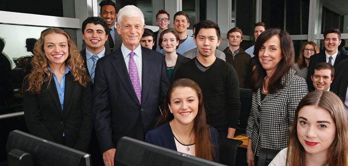 1965 Fordham graduate Mario Gabelli with students in February 2015